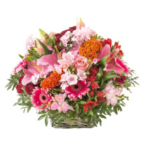 funeral basket of orange and pink flowers